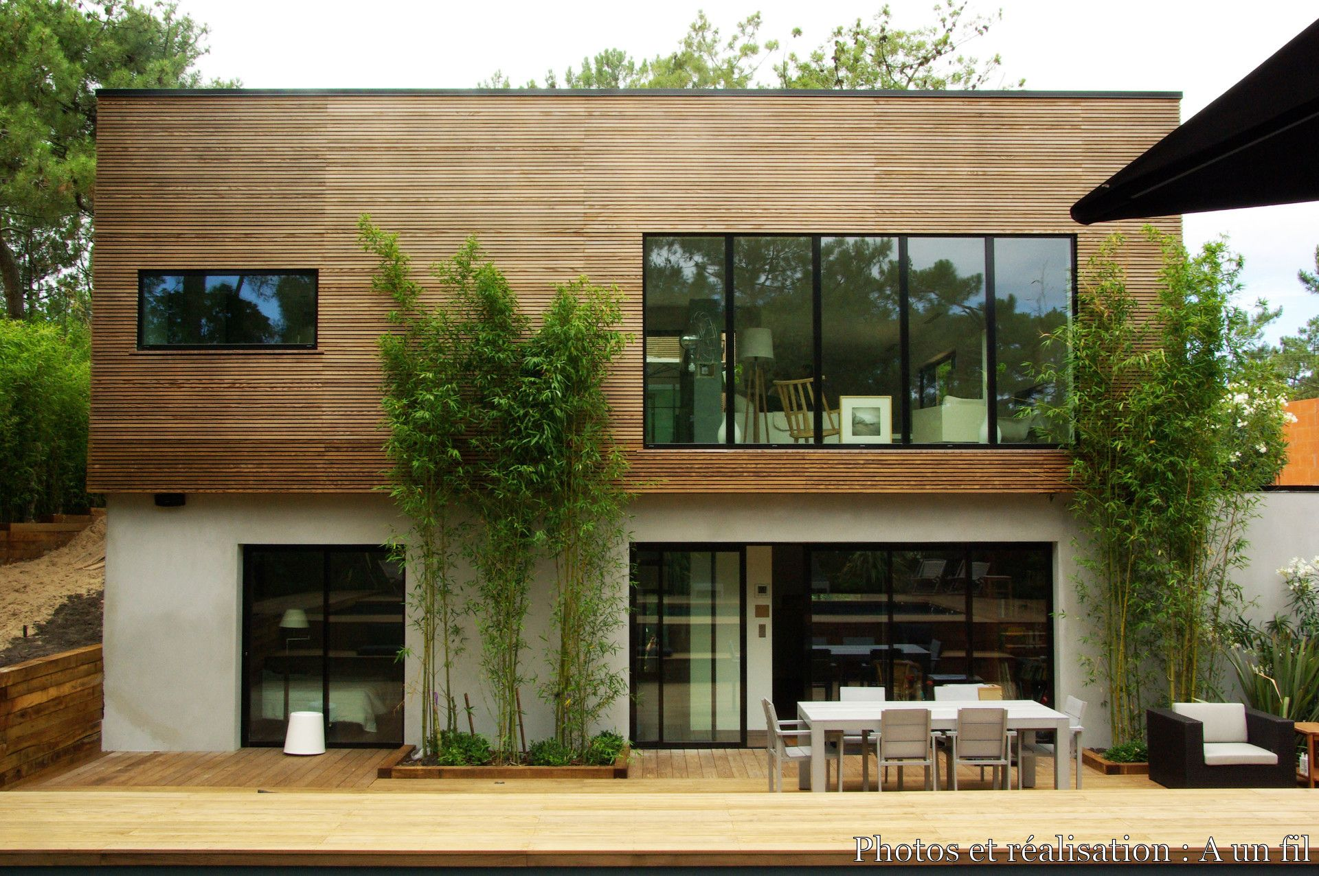 Maison bois contemporaine cap ferret a un fil c t for Projet maison contemporaine