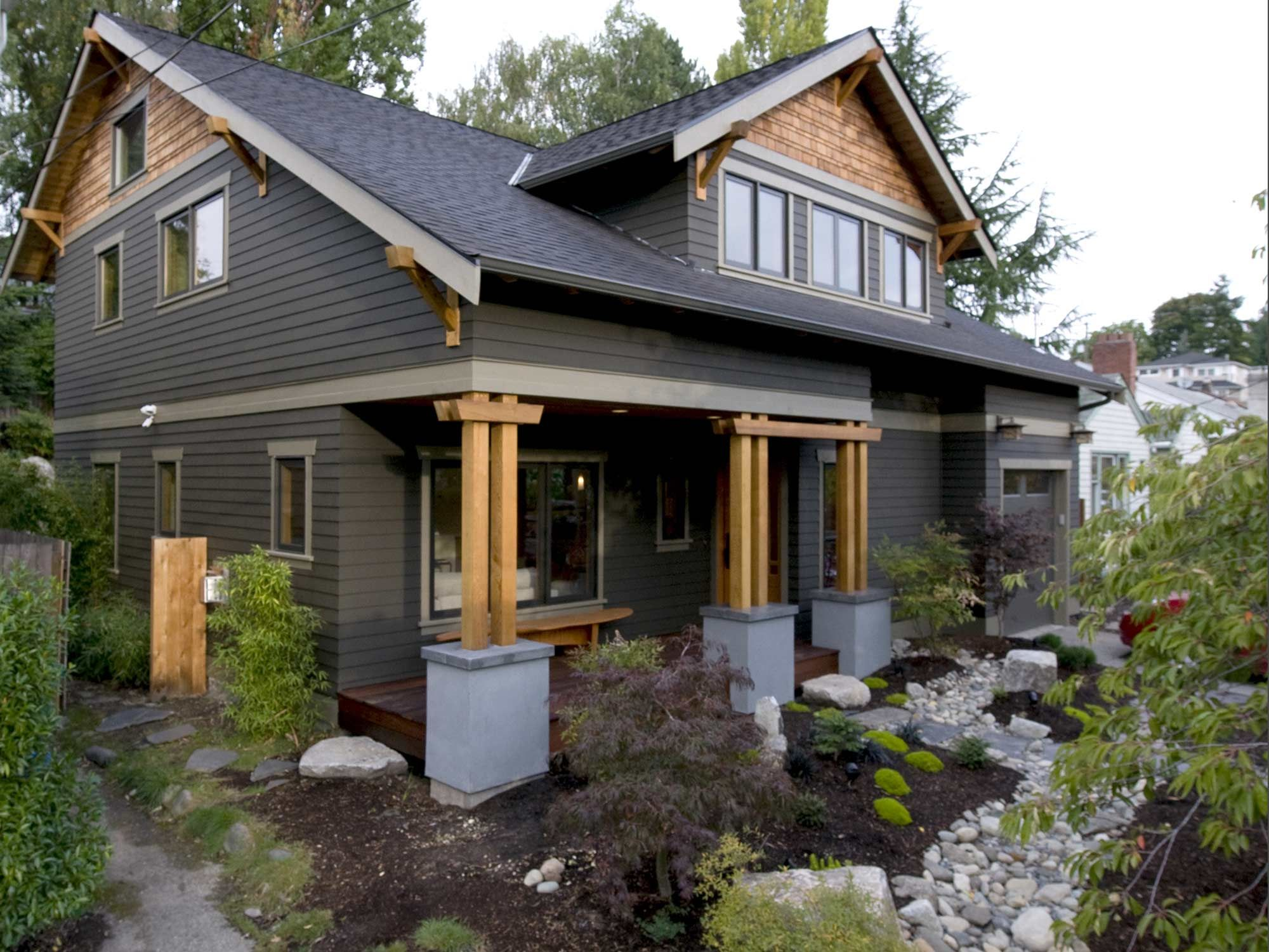 This Zen Craftsman Is A Second Story Addition And First Floor Renovation Of A 1940 S Home Emphasizing Abundant Natural Light Indoor Craftsman Exterior Craftsman Home Exterior Black House Exterior