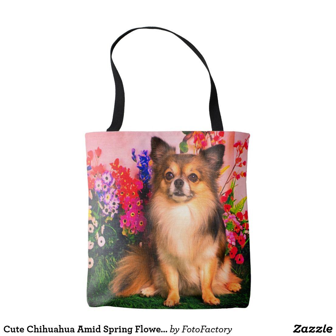Cute chihuahua amid spring flowers tote bag