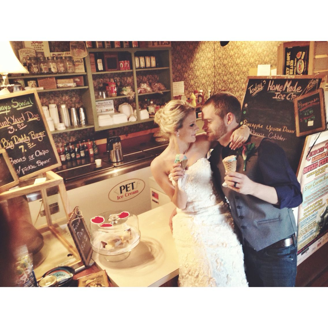 Bride and groom photos at the local ice cream shoppe.   Amber s. Wallace photography   Location: Destarte Wedding Barn, Lawndale, NC