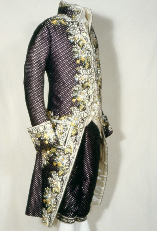 7e34c24eb1 Court Suit, 1770-1785, French, silk, velvet, satin, cotton. Purple velvet  coat and breeches, lavishly embroidered with naturalistic flowers; ...