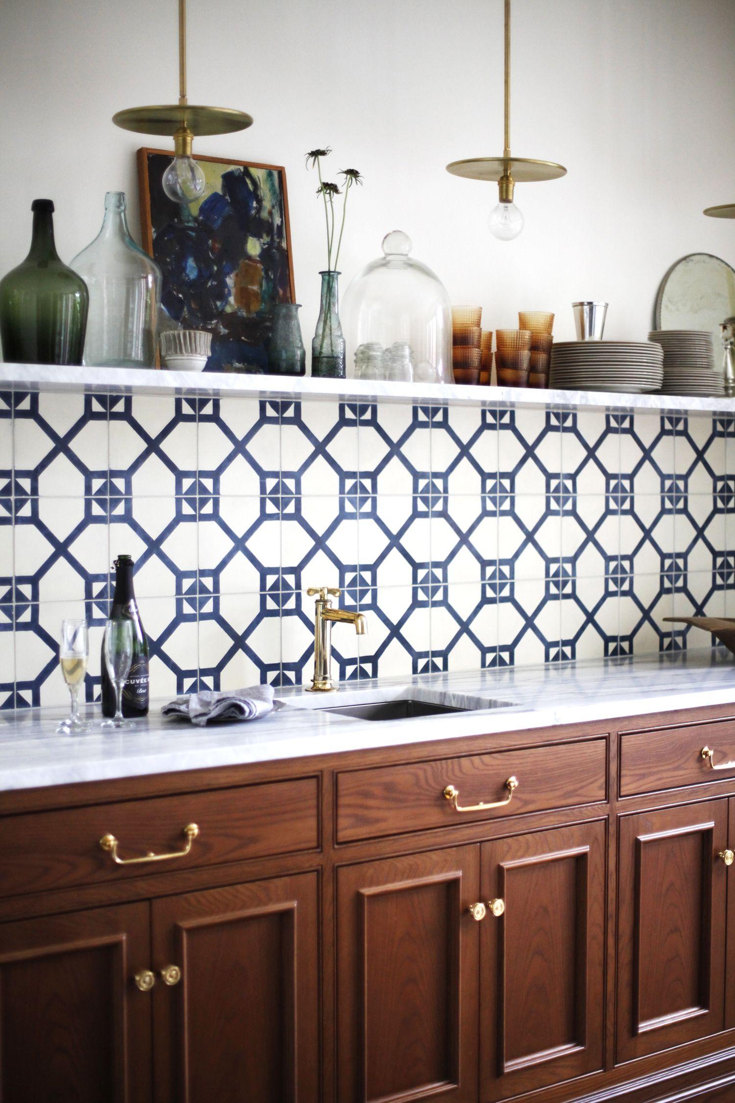 - Blue Patterned Tile Backsplash With Single Marble Open Shelf