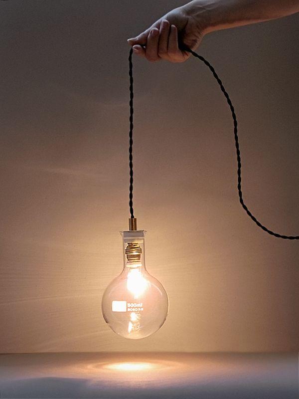 Laboratorio lamp - Anve  3a 4 in verschillende maten bij elkaar op de grond of zo