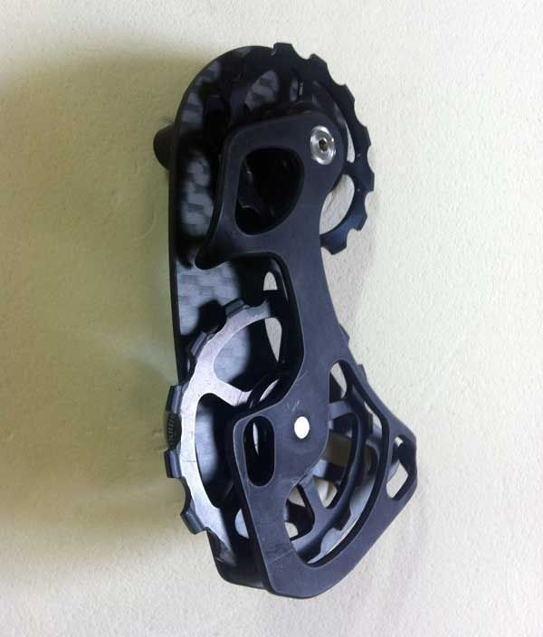 58995c28770 Germany's Berner Bikes makes carbon fiber upgrade parts and accessories,  carbon road and 'cross frames and other bits. These replacement derailleur  cages ...