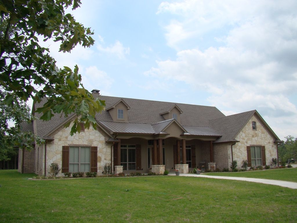 Located on a large texas ranch this inviting home was for Big ranch house plans