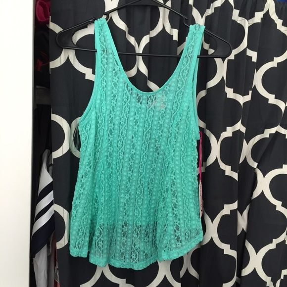 Mint green Lace Candie's Tank This tank top is brand new with tags and super cute. It's sheer lace and would look good with a bandeau. The first picture is the front, the second is the back. Make me an offer! Candie's Tops Tank Tops