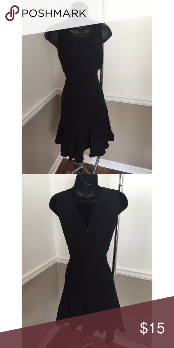Black dress with flare at the bottom New Never Worn - This basic black dress is an essential for your wardrobe. Dresses Midi