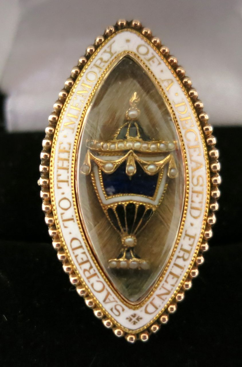 A gold, enamel and human-hair brooch-pendant, c.1783, with the words 'Sacred to the memory of a deceased friend; engraved on the back: 'Tmonty Oscley, OB 9 July, 1783, At 37'.  (rubylane.com )