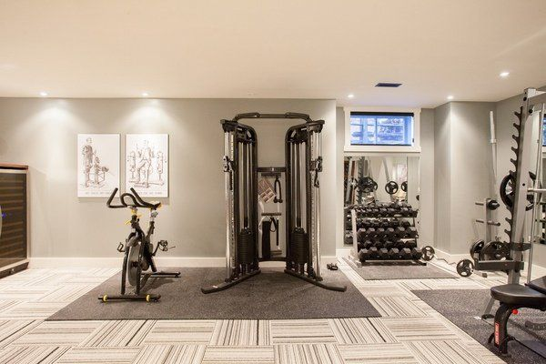 Contemporary home gym flooring rubber and carpet tiles gray walls