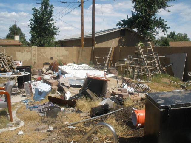 backyard ref lots of piles of junk garbage back yard ugly messy mesa arizona home house for sale. Black Bedroom Furniture Sets. Home Design Ideas