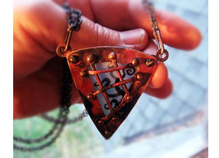 Nautical Steampunk pendant, made in copper, with tentacles in the little window!