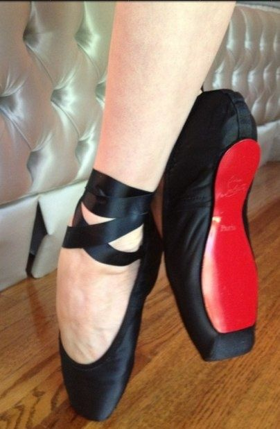 Custom Christian Louboutin pointe shoes featuring signature red sole.