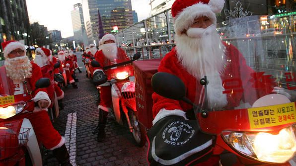 in seoul south korea postmen dress up as santa claus and ride motorcycles to deliver the mail christmas has become increasingly popular over the years in - When Did Christmas Become A National Holiday