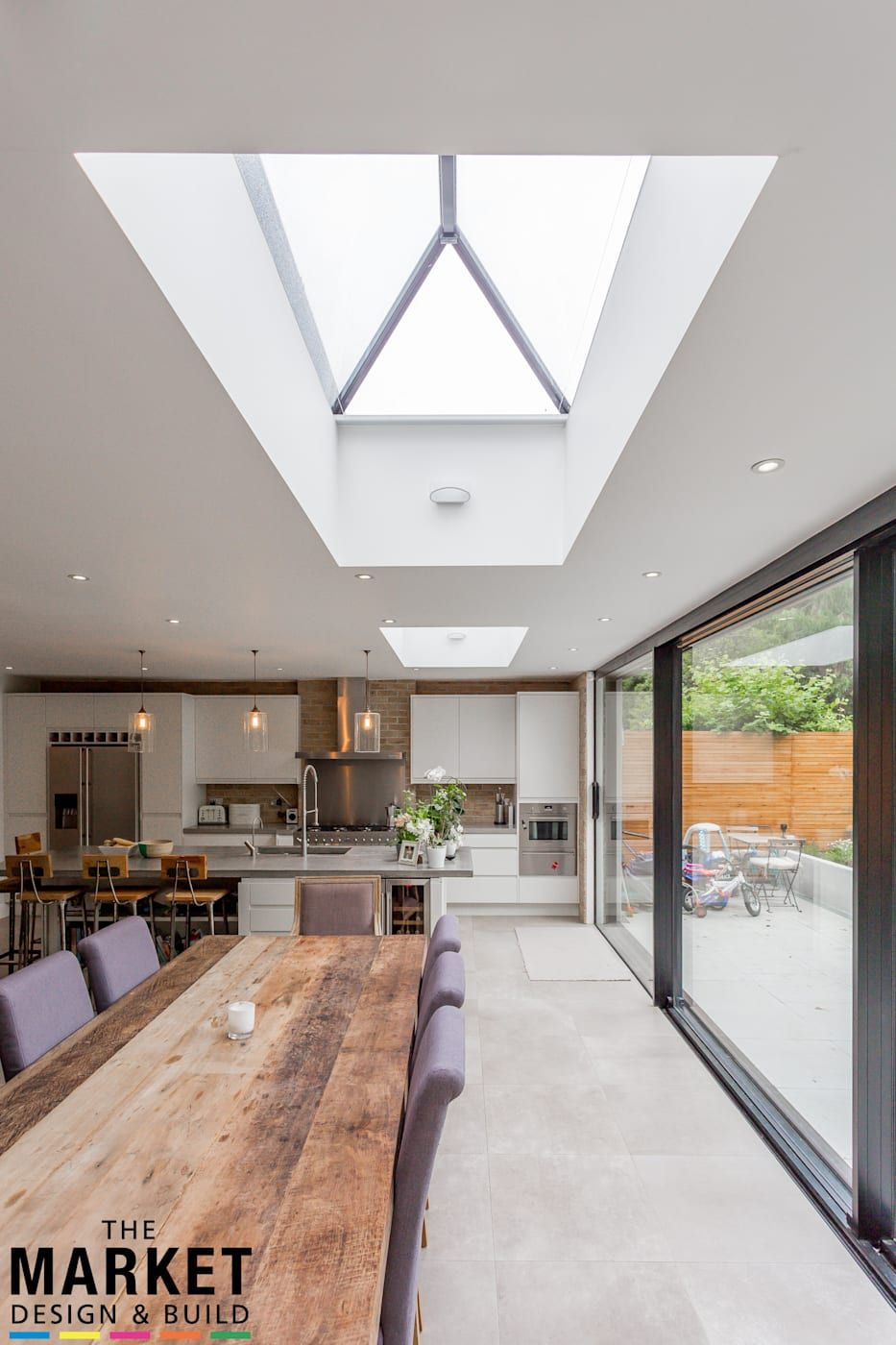 7 Stunning Home Extension Ideas: Stunning North London Home Extension And Loft Conversion Modern Dining Room By The Market Design