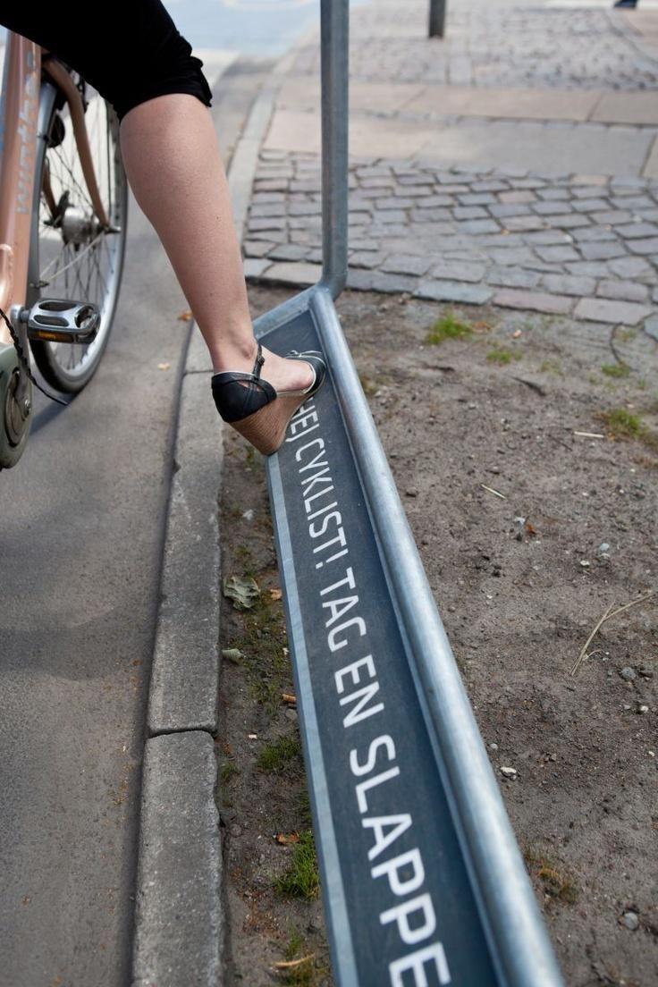 Handy and elegant red light footrest in #cycle-friendly #Copenhagen. Click image to tweet. Visit the slowottawa.ca boards >> https://www.pinterest.com/slowottawa/