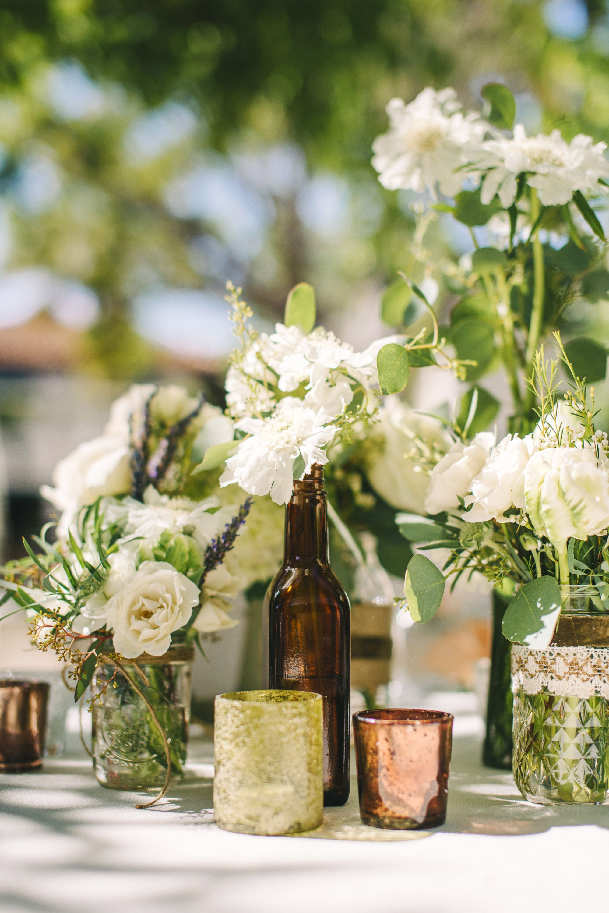 Glass Bottles For Wedding Decorations Ivory Flowers In Glassbottle Centerpiece  Elyse Wedding Ideas