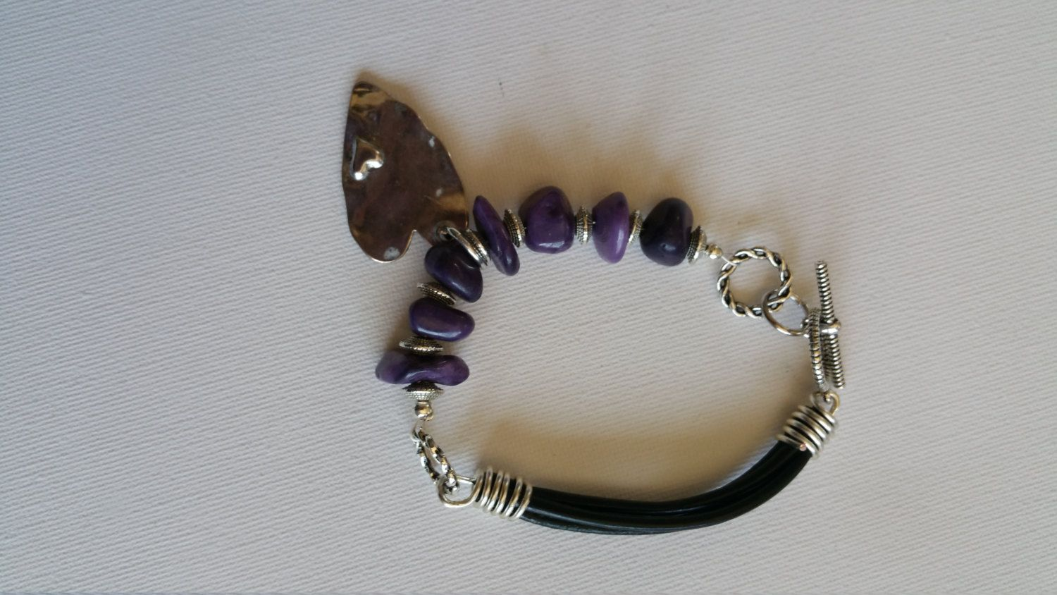 made to order, purple rough coloured stone, black leather half bracelet, silver hanging heart, silver toggle by DeeJewelryBox on Etsy