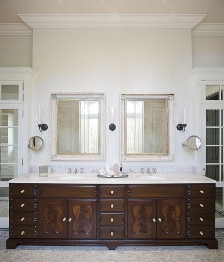 bathroom sconces. Love the dark wood and white marblegranite tops When I redo my Sconces bathroom