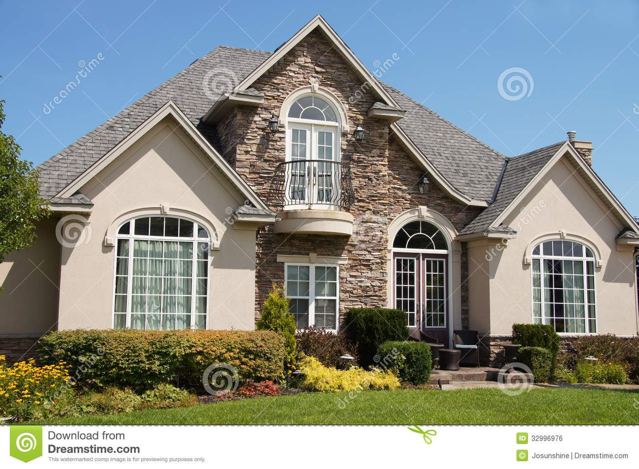 Stucco stone house pretty windows royalty free stock image for Stucco stone exterior designs