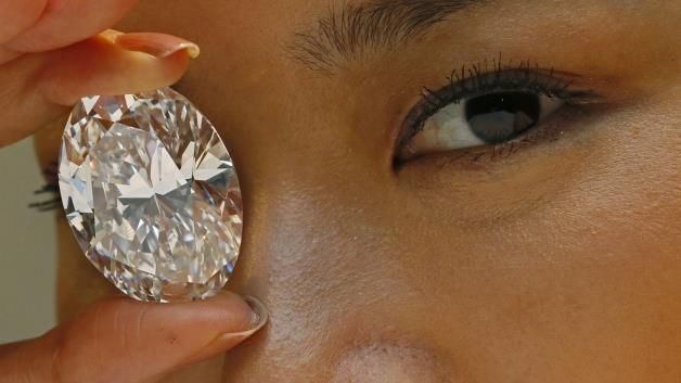 White diamond auction record: A 118.28-carat white diamond is displayed by a model at a press preview at Sotheby's auction house in Hong Kon...