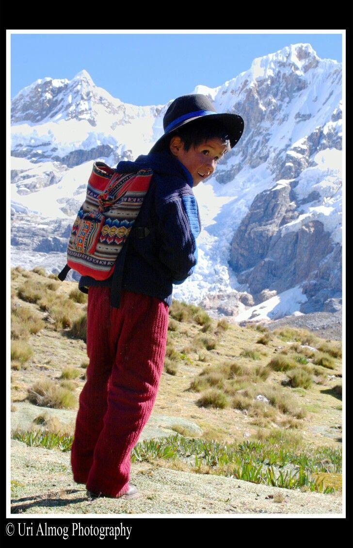 A boy on his way to school in the Huayhuash range, Peru
