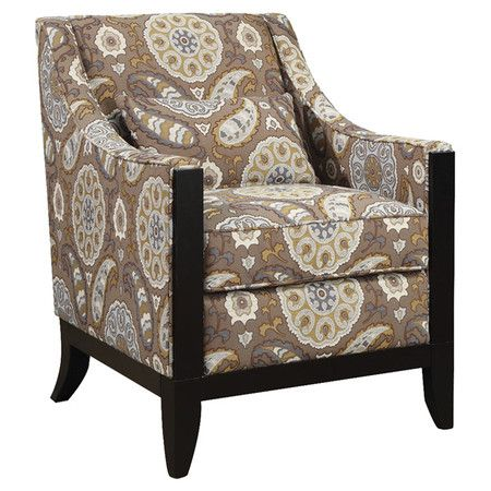Medallion-print arm chair with wood legs.   Product: ChairConstruction Material: WoodColor: Brown...
