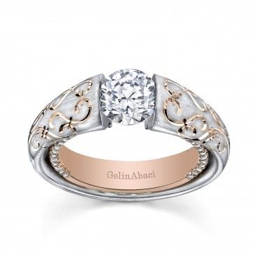 Tension-set diamond, platinum and rose gold engagement ring by Gelin Abaci