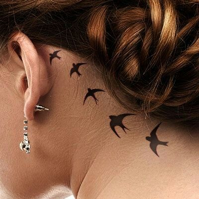 I'm liking these simple behind the ears tattoos. ...I can let my hair down and conceal it, while at work.