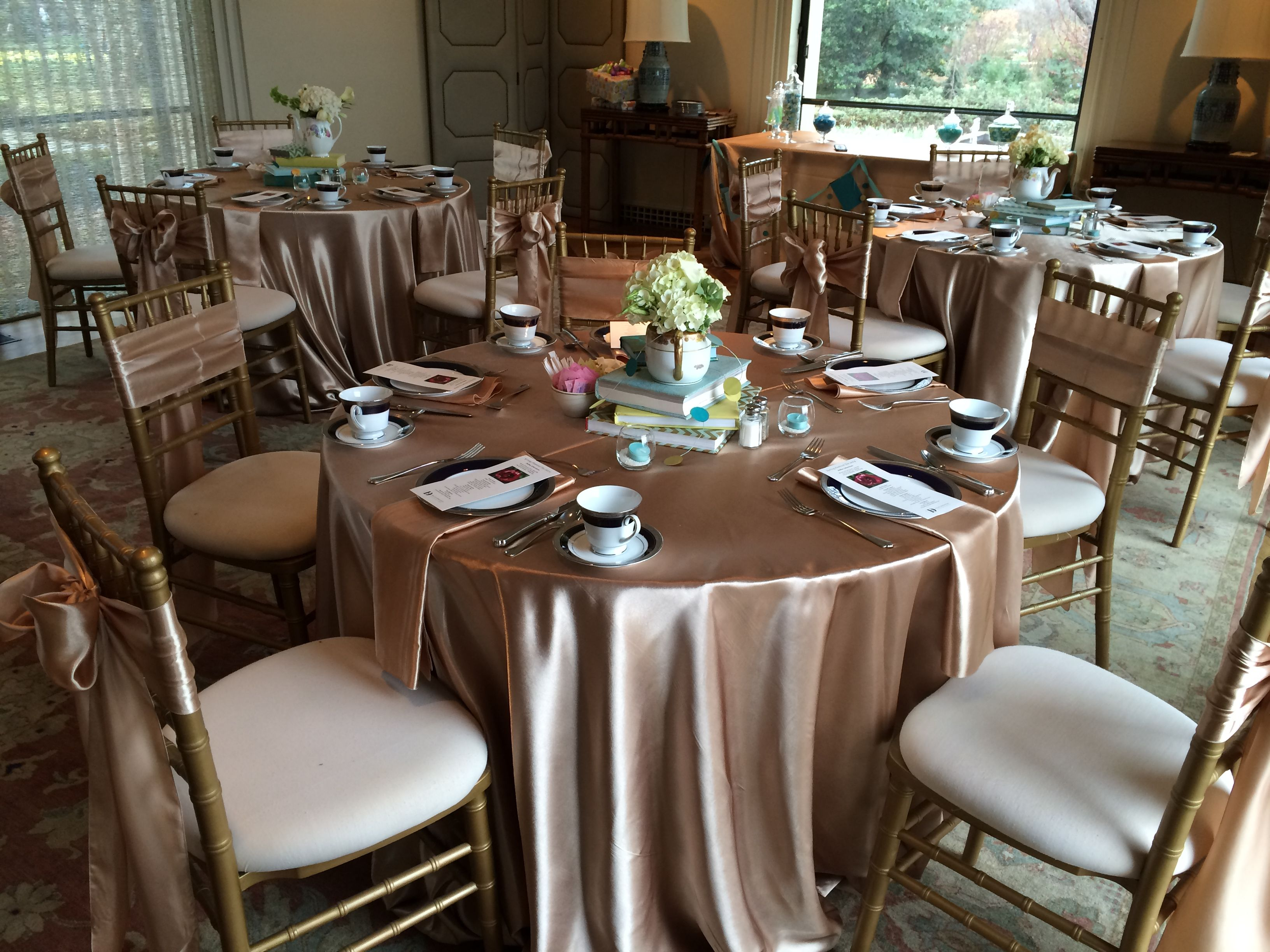Champagne Satin tablecloths napkins and sashes