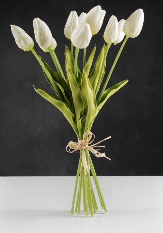 17.00 SALE PRICE! Set the tone with this beautiful white tulip bouquet. The bouquet is composed of twelve natural touch white tulips and is finished with a r...