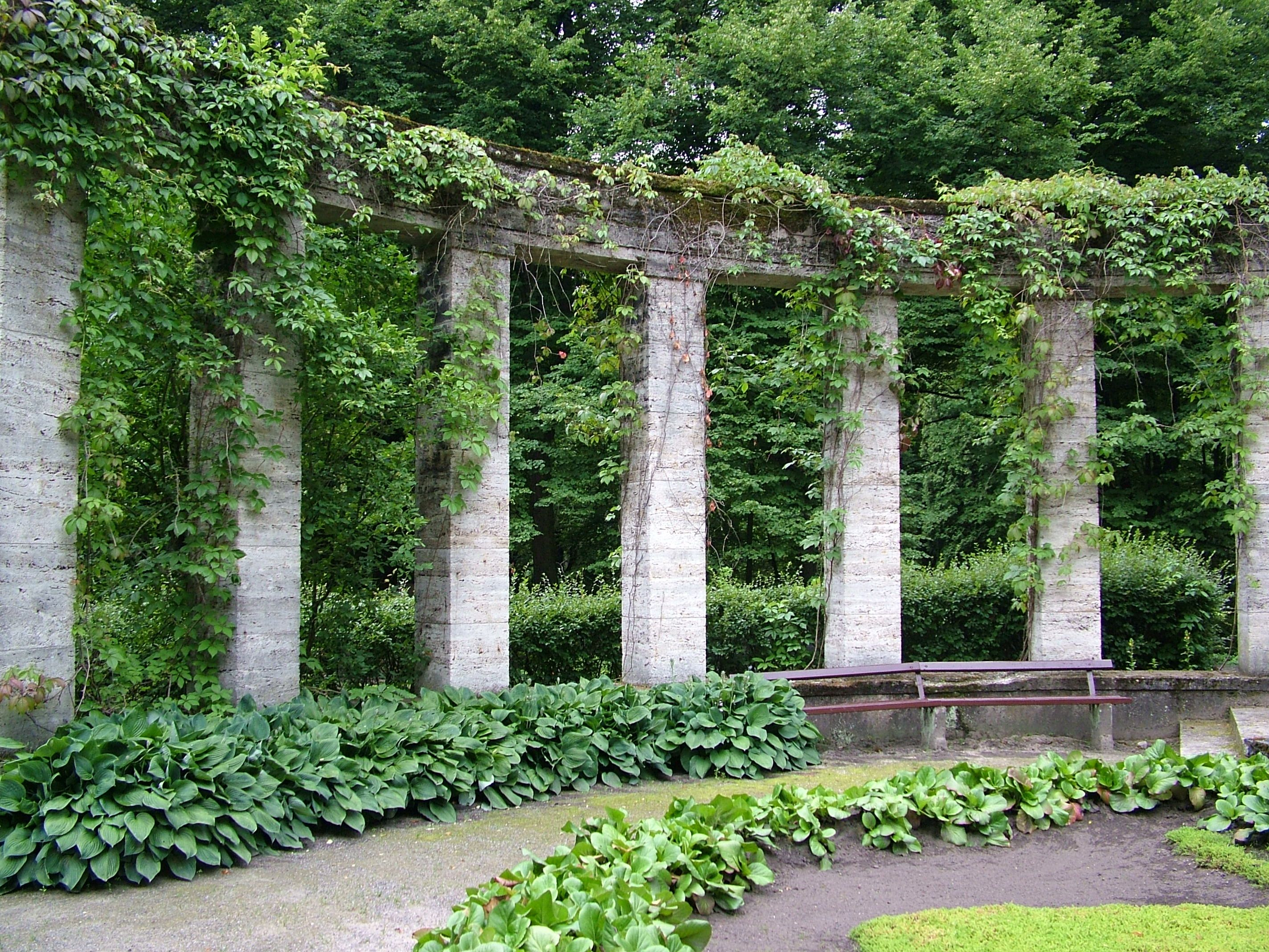 stupendous garden archway. arch arches overgrown garden bench column columns greek ancient