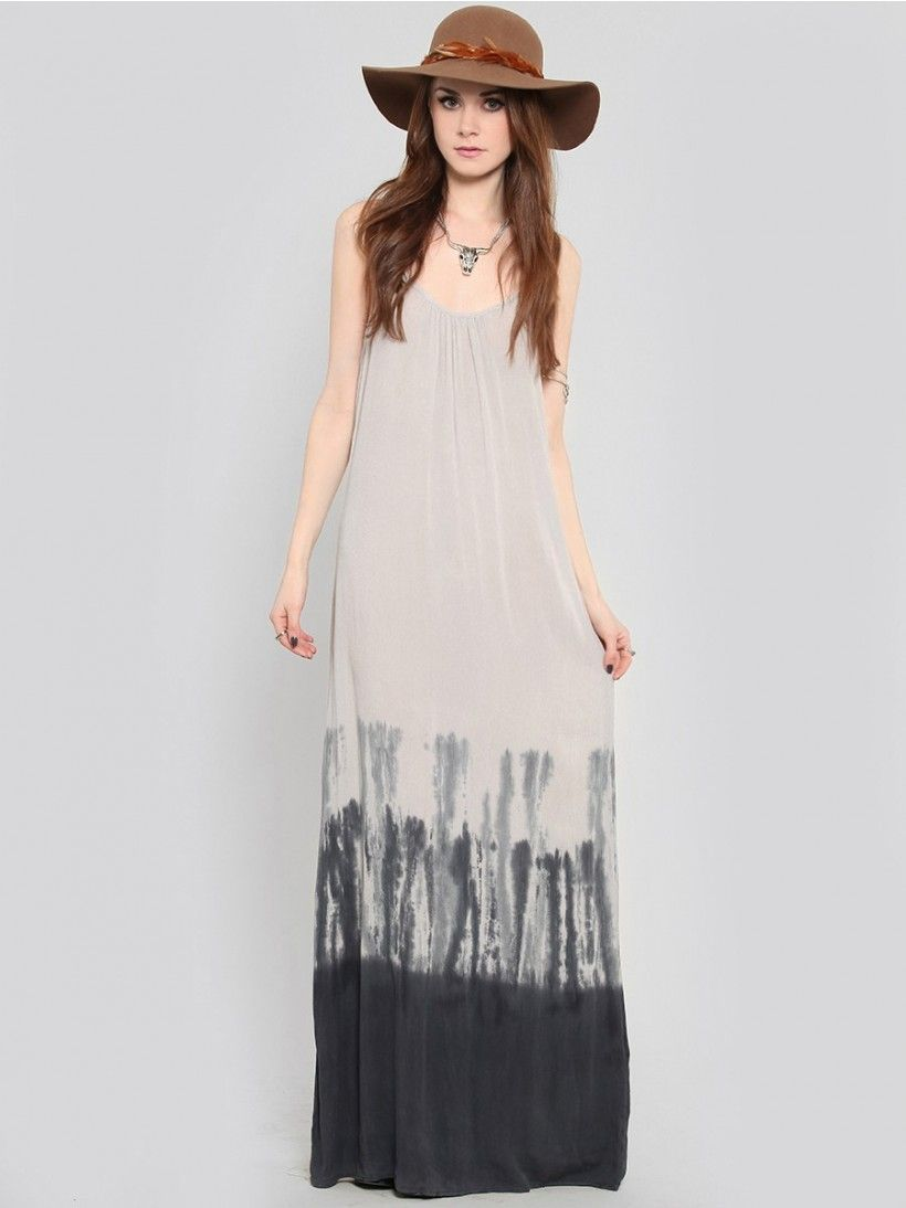 Light taupe maxi dress featuring a dip dye panel near the hemline and a crepe texture. Includes cut-in shoulders that form a racerback neckline at the back with a keyhole and self tie closure. Unlined. Pull on style.