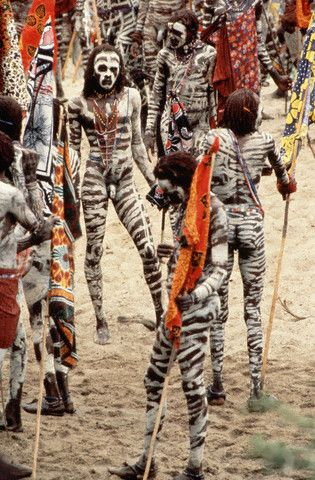Africa |  Sights and Sounds.  Masai Men Painted for an Eunoto Ceremony  The Eunoto ceremony marks the transition of Masai men from warrior status to maturity.