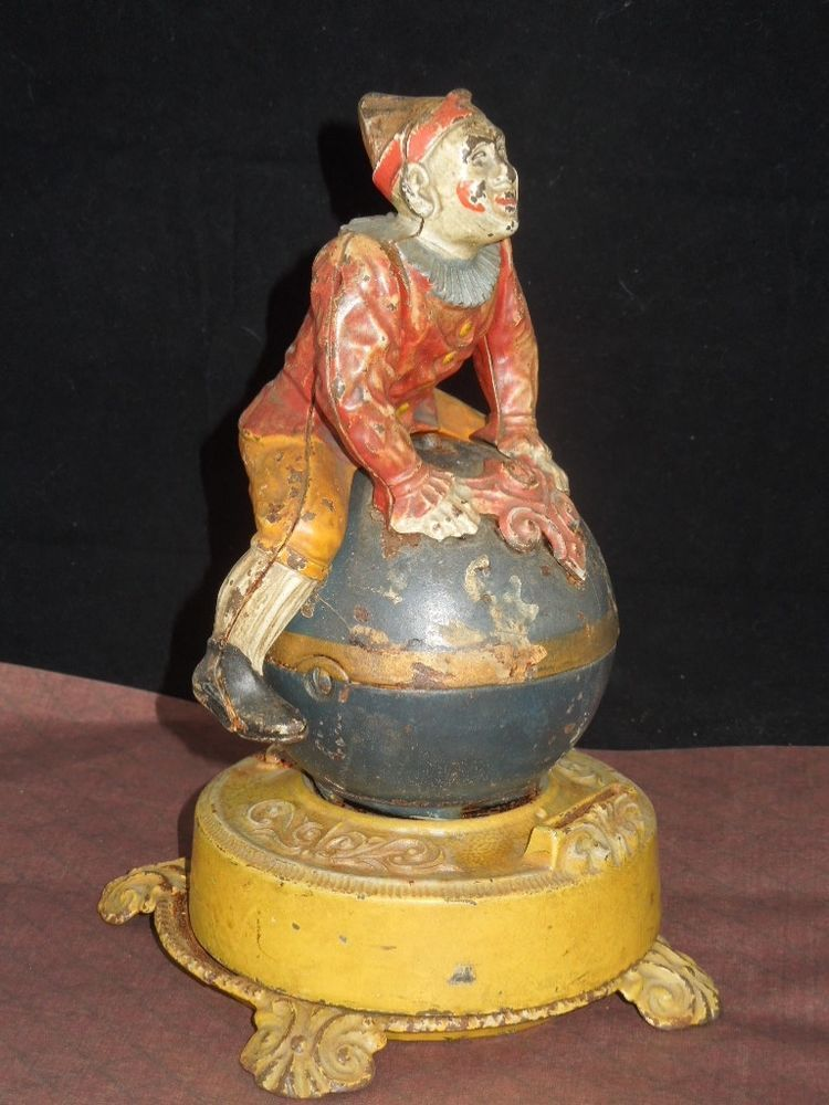 Funny Clown Bank On Globe Cast Iron