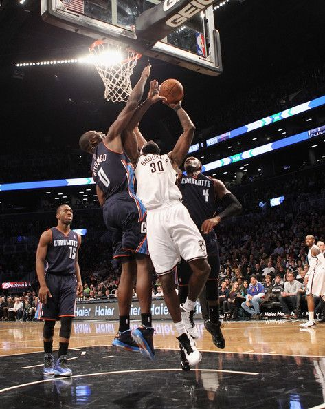 Reggie Evans #30 of the Brooklyn Nets scores two in the fourth quarter against the Charlotte Bobcats at the Barclays Center on December 28, 2012 in the Brooklyn borough of New York City.