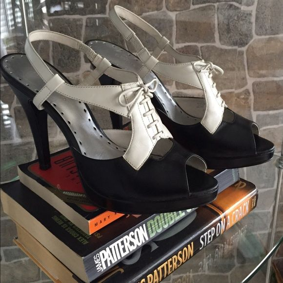 BCBGirls Tuxedo Shoes Fabulous black and white tuxedo style high heels in great condition! Size 9 1/2 ( I wear a 9). BCBGirls Shoes