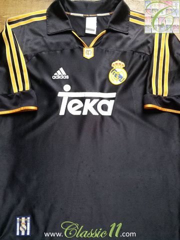 362a8786007 Relive Real Madrid s 1999 2000 season with this vintage Adidas away football  shirt.