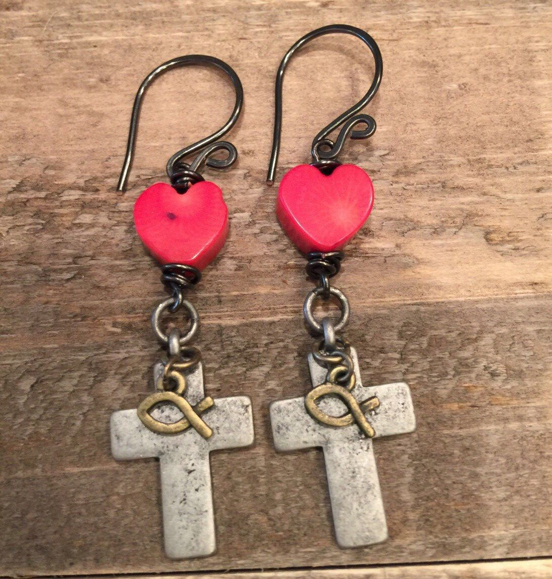 A personal favorite from my Etsy shop https://www.etsy.com/listing/398344051/antique-silver-cross-with-fish-red-coral