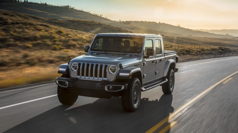 Display Grey Gladiator Driving Down The Highway Jeep Gladiator Jeep Gladiator