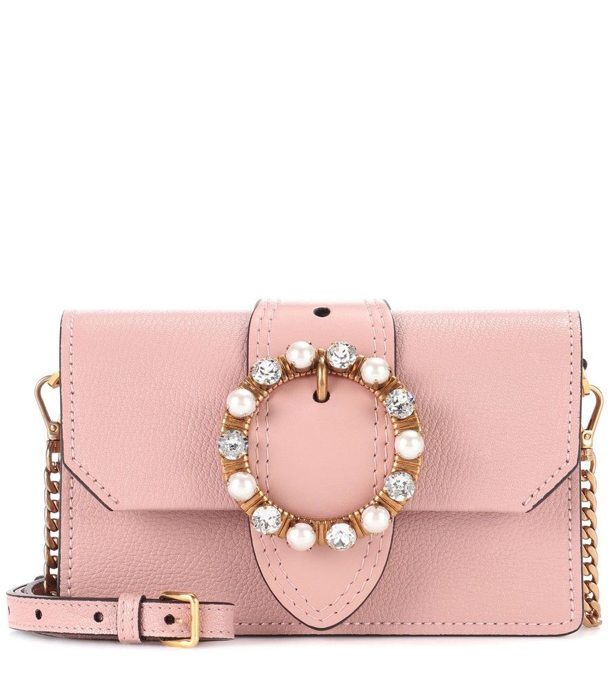 Miu Miu - Leather shoulder bag - Lend your ensemble an evocatively feminine note with Miu Miu's petite leather shoulder bag. The blush-pink miniature style comes with oversized buckle detailing and finishes with faux pearl and crystal embellishments for shimmer. Swing yours over your shoulder next to pastel-hued ensembles for a dose of the label's girlish attitude. seen @ www.mytheresa.com