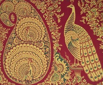 Textile sample with hand block printed design of five peacocks within a large paisley motif and one large peacock to the right with floral borders, c1860. Image courtesy of National Museums Scotland with kind permission of Coats plc
