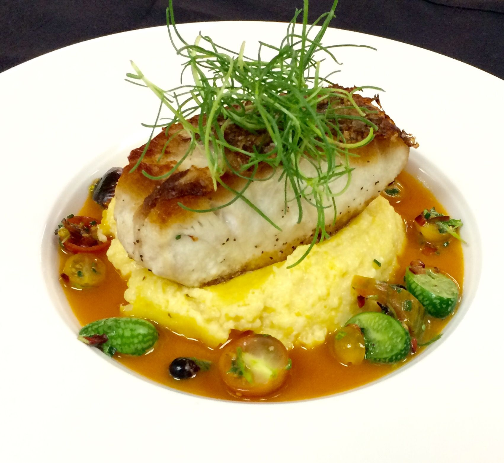 Striped bass, goat cheese polenta, blood orange buerre blanc, pineapple tomatillo salsa