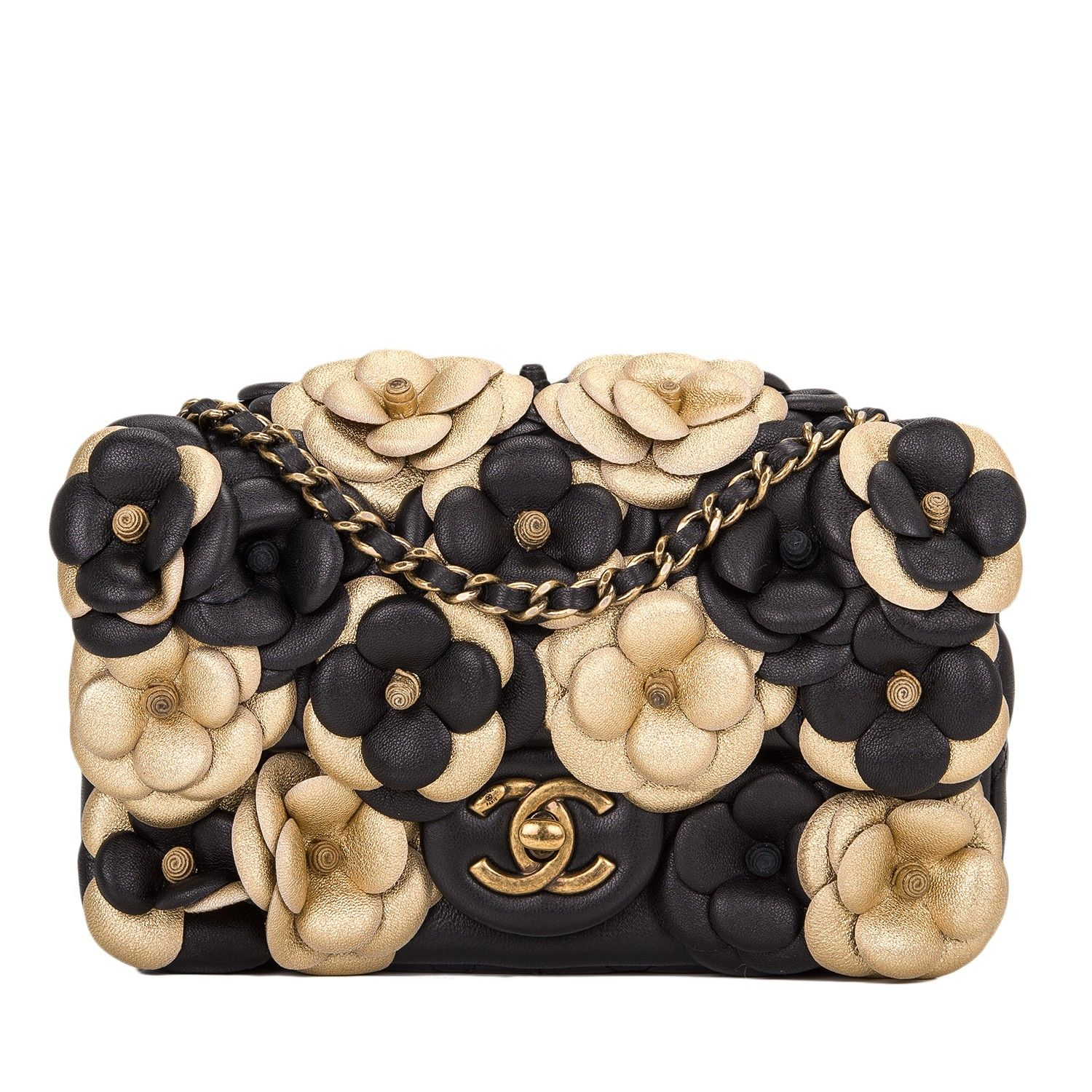 4d06a9b37b55 Chanel Black Camellia Flap Bag - This Camellia flap bag featuring beautiful  hand stitched black and gold leather camellia flowers is fast becoming a ...