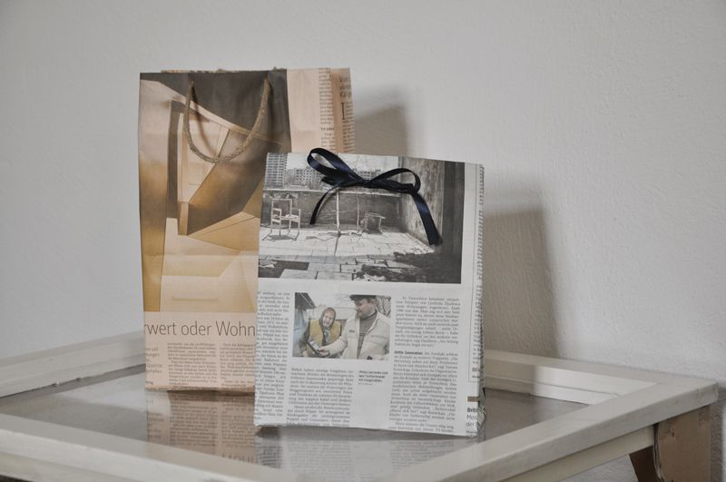 This newspaper bags relatively easy to make yourself with a loop upcycling newspapers as gift bags you could even save newspapers from peoples birthdays to make into a gift bag for next year solutioingenieria Choice Image