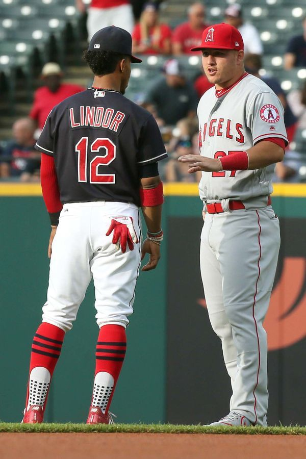 Cleveland Indians Francisco Lindor Talks With The Los Angeles Angels Mike Trout Before The Game At Prog Baseball Camp Cleveland Baseball Cute Baseball Players