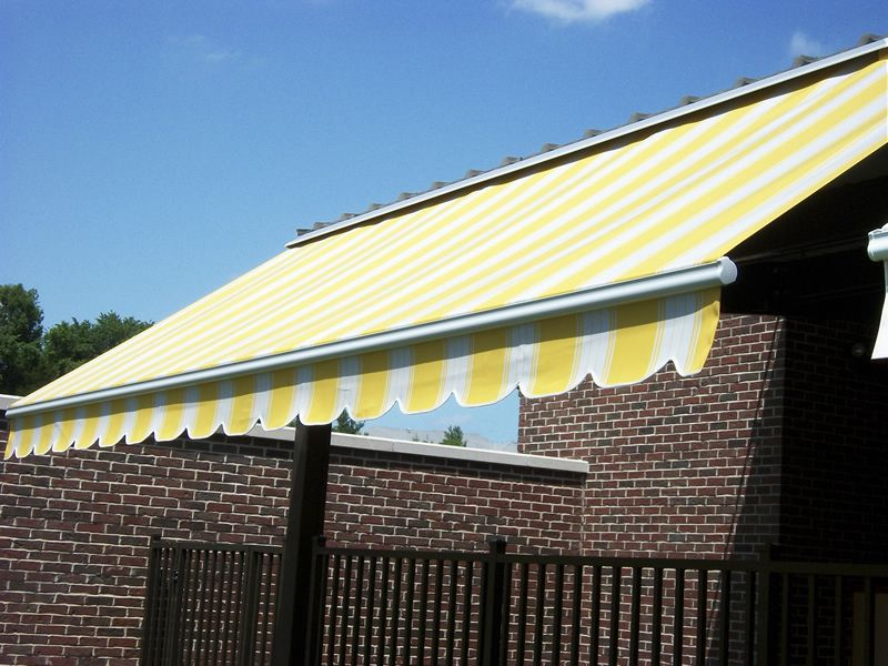 Retractable Eko Awning With Yellow Striped Fabric And Scalloped Valance Semi Cassette And Flush Mounted Outdoor Decor Homeowner Awning