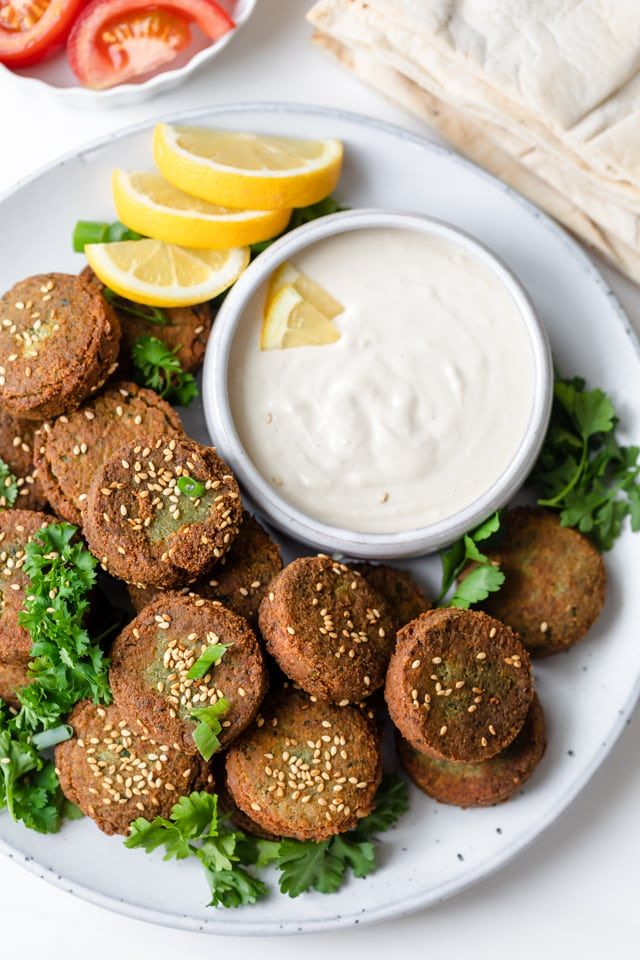 Lebanese Falafel This authentic Lebanese falafel recipe is a popular Middle Eastern dish that's made with chickpeas, herbs, onion & spices - vegan, gluten-free and delicious | Arabic Food | Vegan Recipes | Plant-based protein | Mediterranean Food | Baked | Fried | Easy | Healthy | Sandwich | Wrap