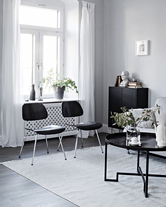 Grey home with a black kitchen - via Coco Lapine Design
