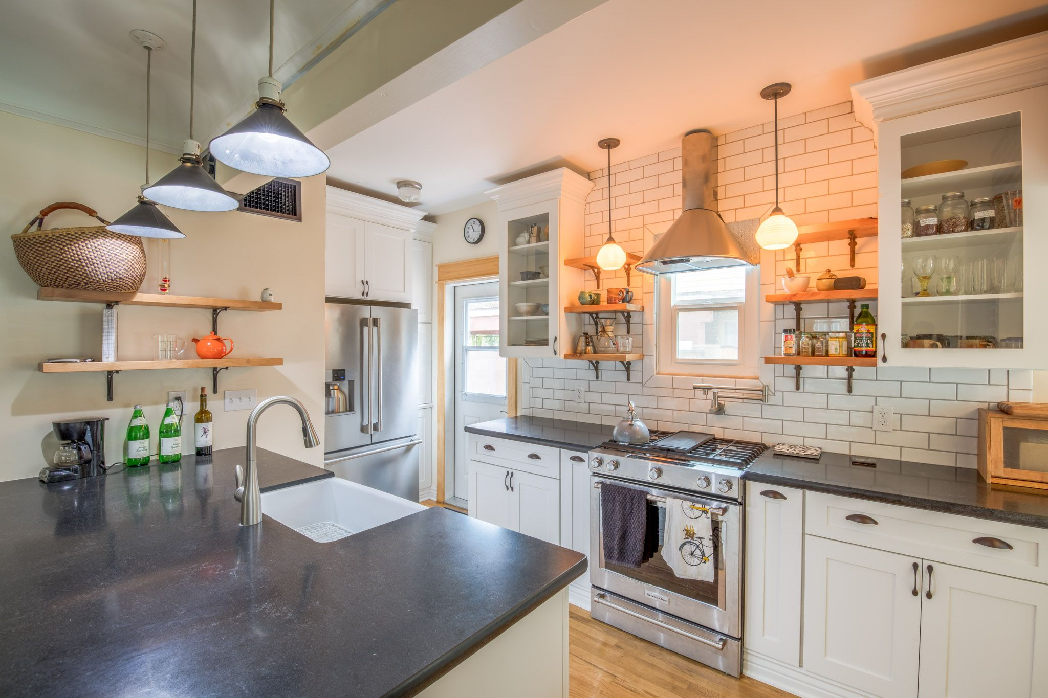 Beautiful white shaker kitchen with open shelving tiled wall and