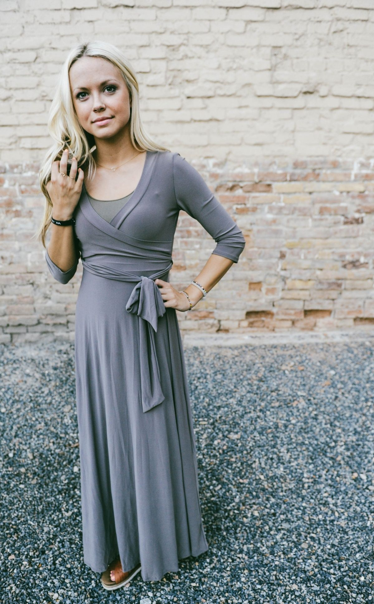 "You will surely turn heads in our Fall Solid Wrap Maxi Dress. The illusion wrapped waist, amazing fit, & gorgeous colors will become your ""go-to"" dress for all occasions! Pair with one of our statement necklaces & stacked bracelets for a jaw dropping ensemble."